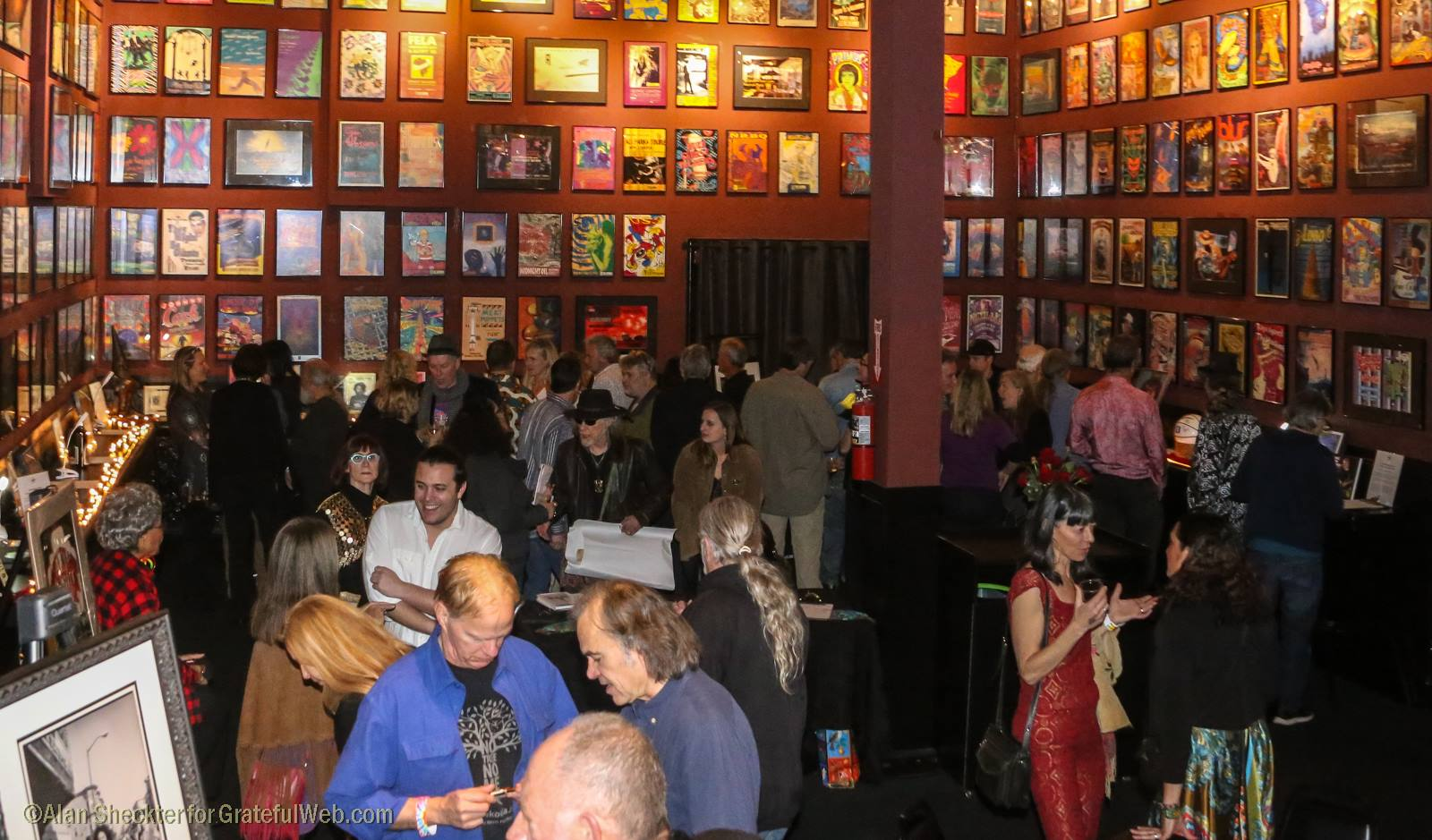 Attendees mingle around the second-floor silent auction for the Rex Foundation | The Fillmore