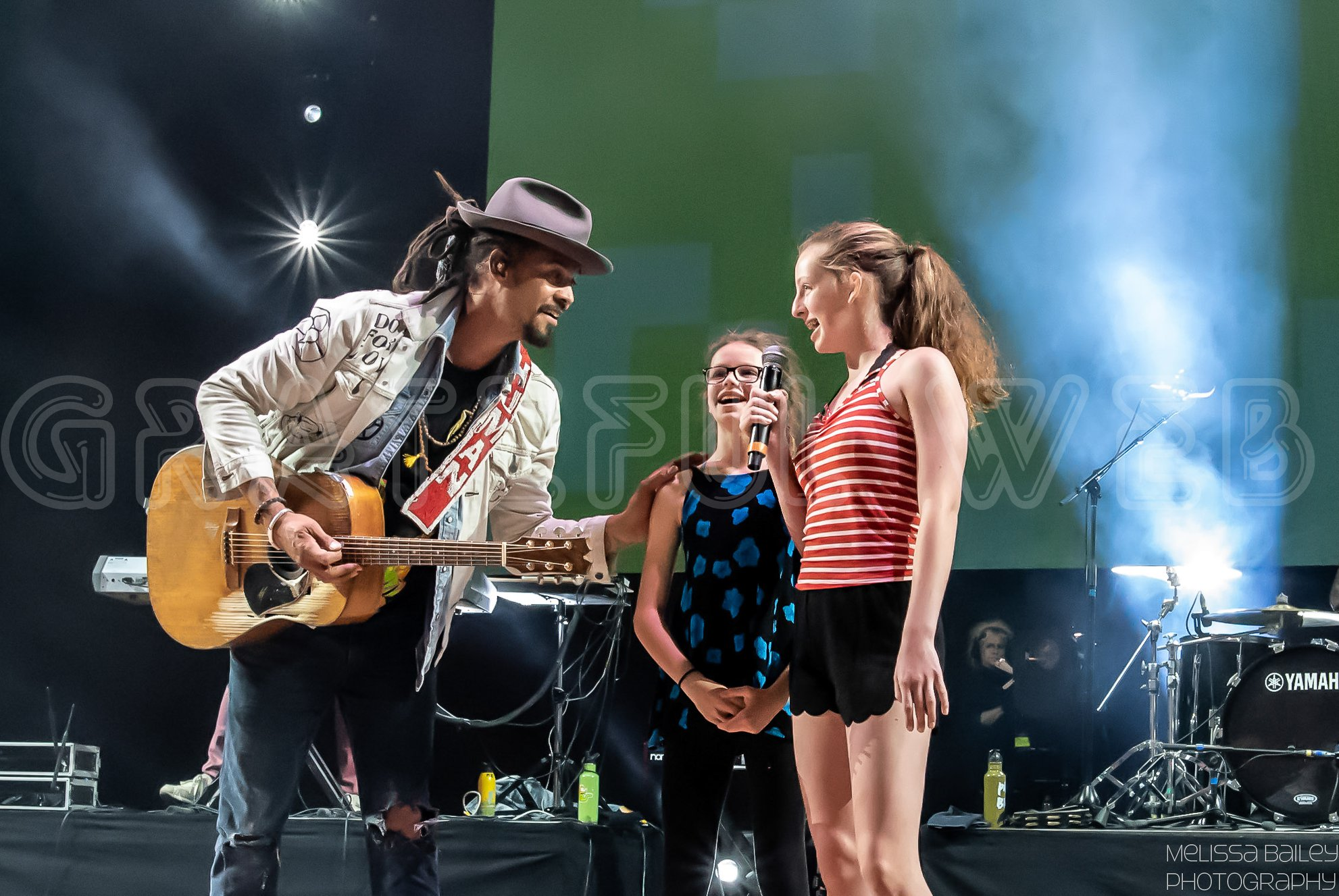 Michael Franti introduces some wonderful young singers to the stage