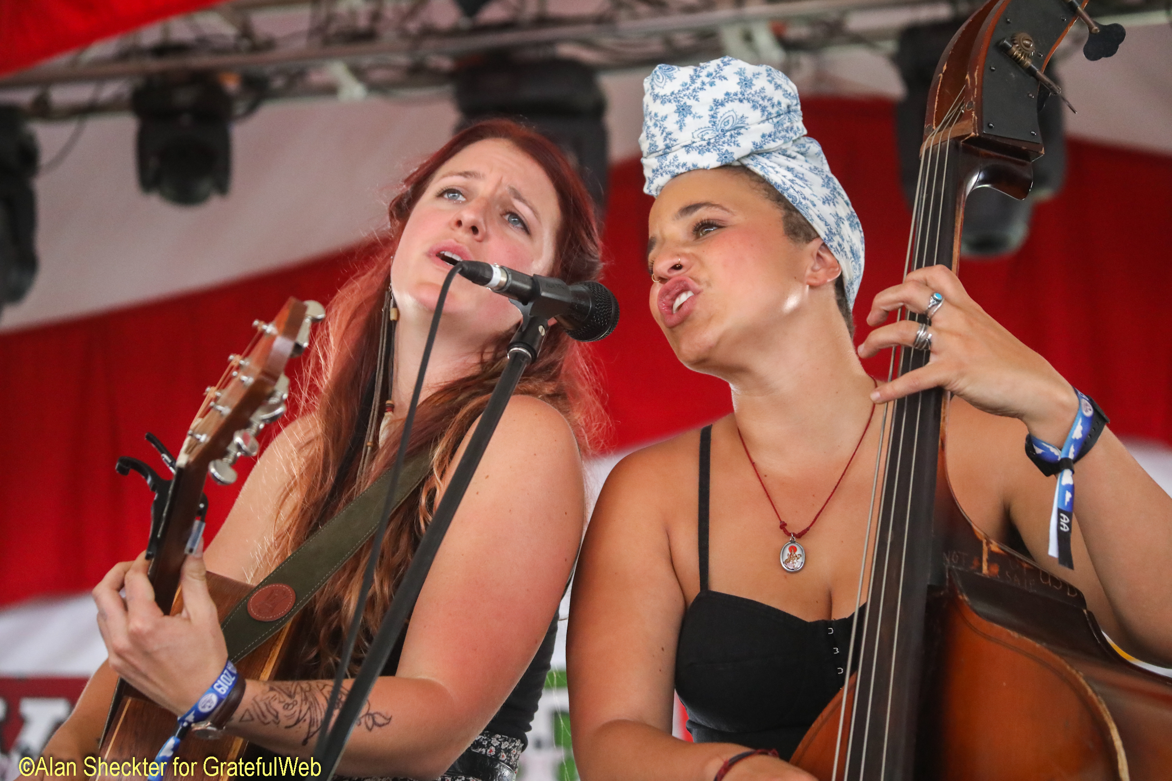 The Rainbow Girls' Erin Chapin (left) and Vanessa May harmonize in the Vaudeville Tent on Friday